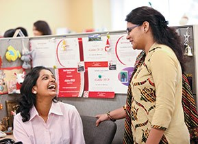 Two team members talking at Target India HQ