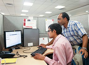 Two Target India IT team members working together