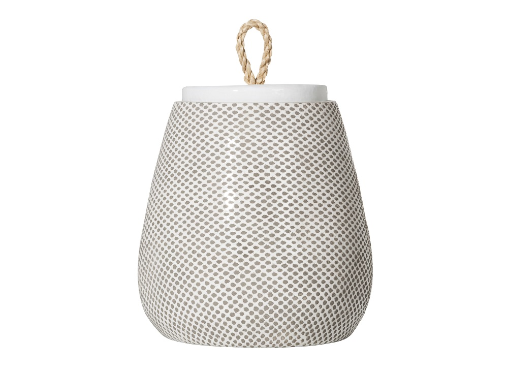 A white ceramic jar with gray dots from the Threshold collection