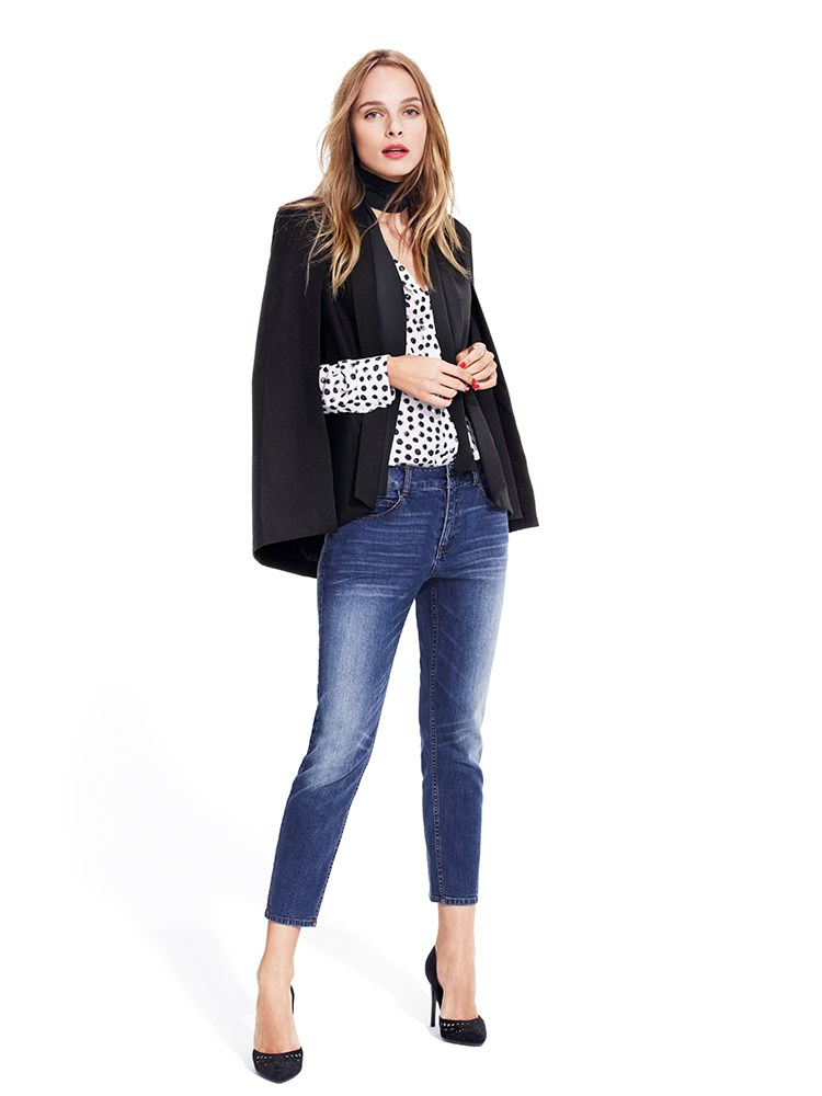 A model wearing a blouse, blazer, jacket, scarf and jeans from the Who What Wear collection