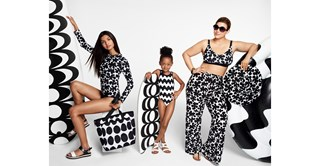 Two women and a young girl in black and white apparel from the Marimekko for Target collection.