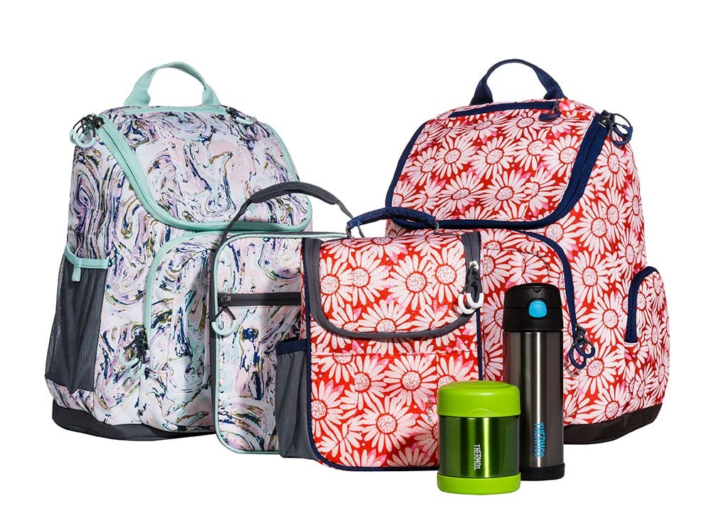 Colorful Patterned Backpacks And Lunch Bags Plus A Food Jar Water Bottle