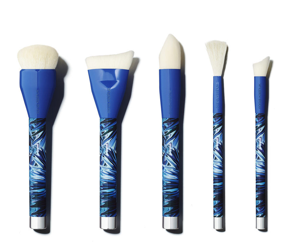 Five makeup brushes with blue patterned handles
