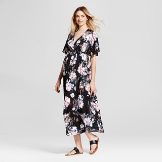 A black midi-length v-neck dress with short sleeves and light pink floral pattern