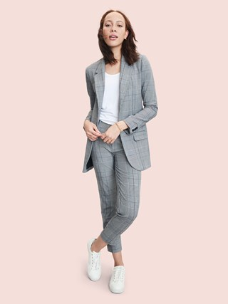 A model wearing a blazer, tee and pants from A New Day