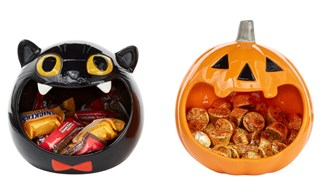 A round black cat head bowl and a round orange jack-o-lantern bowl