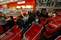 Guests enter a Target store to take advantage of Target's Black Friday deals and doorbusters