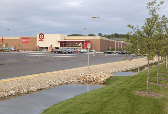 A shot of an irrigation system with a Target store in the far background