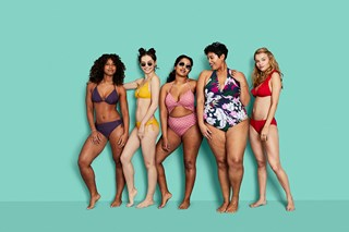 Against an aqua background, four models in solid-colored bikinis (purple, yellow, pink and red) and