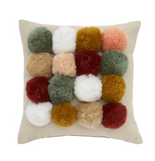 Cream pillow with colorful pom accents