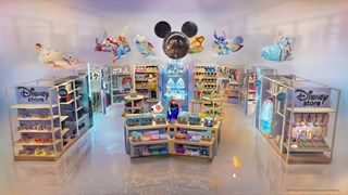 A still rendering of the inside of a Disney store at Target with colorful shelves filled with produc