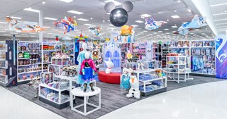 Corner view of the new Disney store at Target, with apparel and toys on white shelves