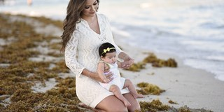 Ana Patricia and her baby at the beach