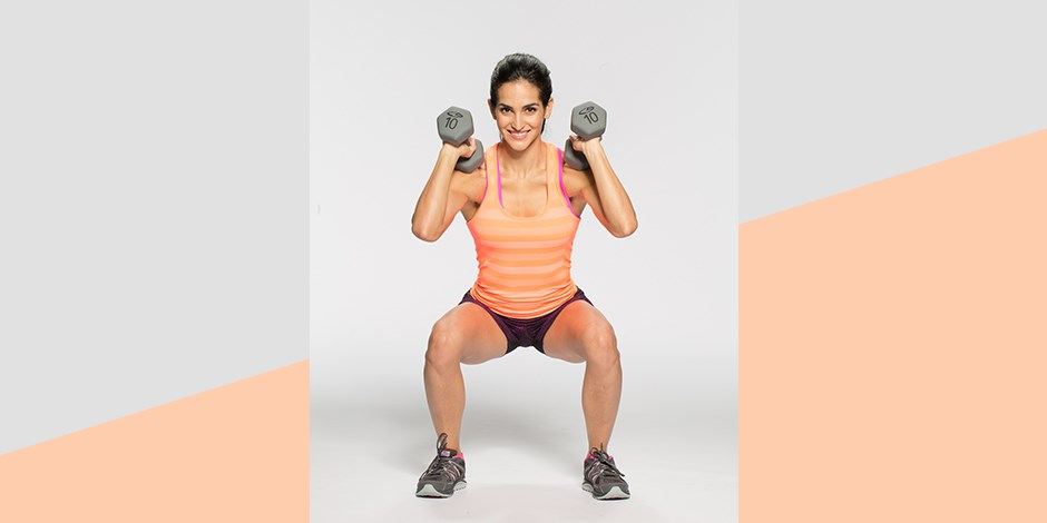 Fitness Trainer Idalis Velazquez squatting in workout gear with two dumb bells in each hand