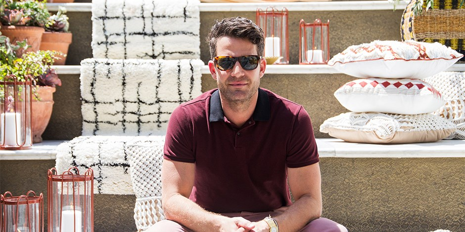 Nate Berkus sits in front of his summer collection display