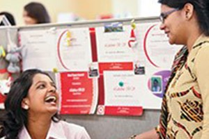 Target team members enjoy conversation in their office