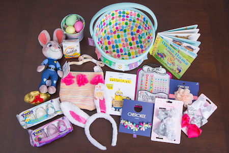 lay down shot of the contents of Mia and Camila's Easter basket, including books, candy, accessories and more.