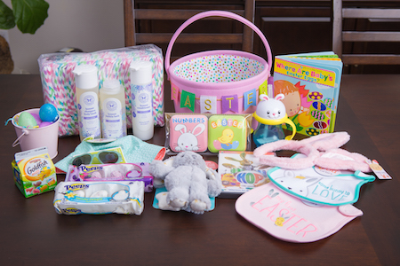 Photo of the supplies for Sofia's basket, including baby body wash, Peeps, toys, books and more.