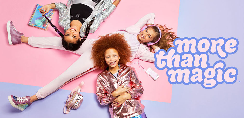 The More Than Magic logo next to three teenage girls on a purple background