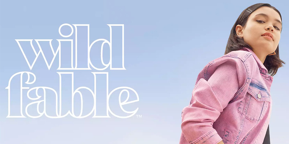 The Wild Fable logo next to a model in a pink denim jacket