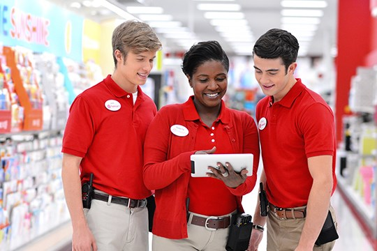 Target team members in store reviewing information on a tablet