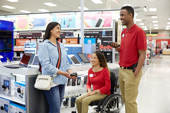 Target store team members assisting a customer in electronics