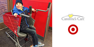 A photo of a boy sitting in a cart, to the left of the Caroline's Cart logo and Target Bullseye logo.