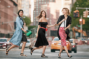 Group of models crossing the street wearing Who What Wear collection.
