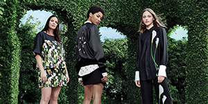 Three models wearing looks from the Victoria Beckham for Target collection
