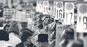 A black and white image of the checkout lanes at one of the first Target stores