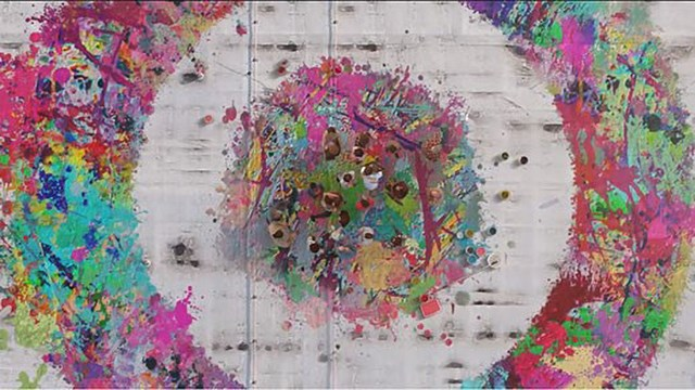 a bullseye made out of multicolor paint splotches