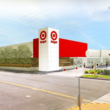 Rendering of new Target store with white and red exterior and parking lot to the right