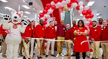 The Brooklyn Midwood, NY, store team cuts the ribbon inside their new store