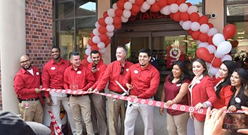 Team members cut the ribbon at the grand opening of Target's USC store