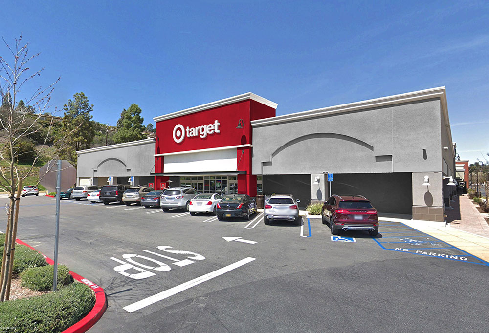 gray stucco building with red center and white bullseye 'target' sign