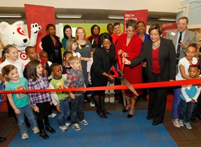 Cutting the red ribbon at a Target giving event