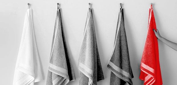 image of five towels hanging on wall