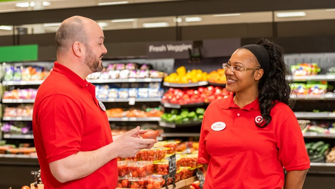 Two team members talk in the grocery department