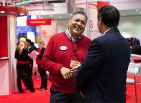 Target team members speaking with perspective employees at recruitment event