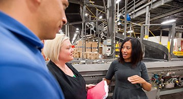 team members meet inside one of Target's distribution centers