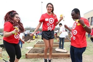 Target team members helping build raised garden beds
