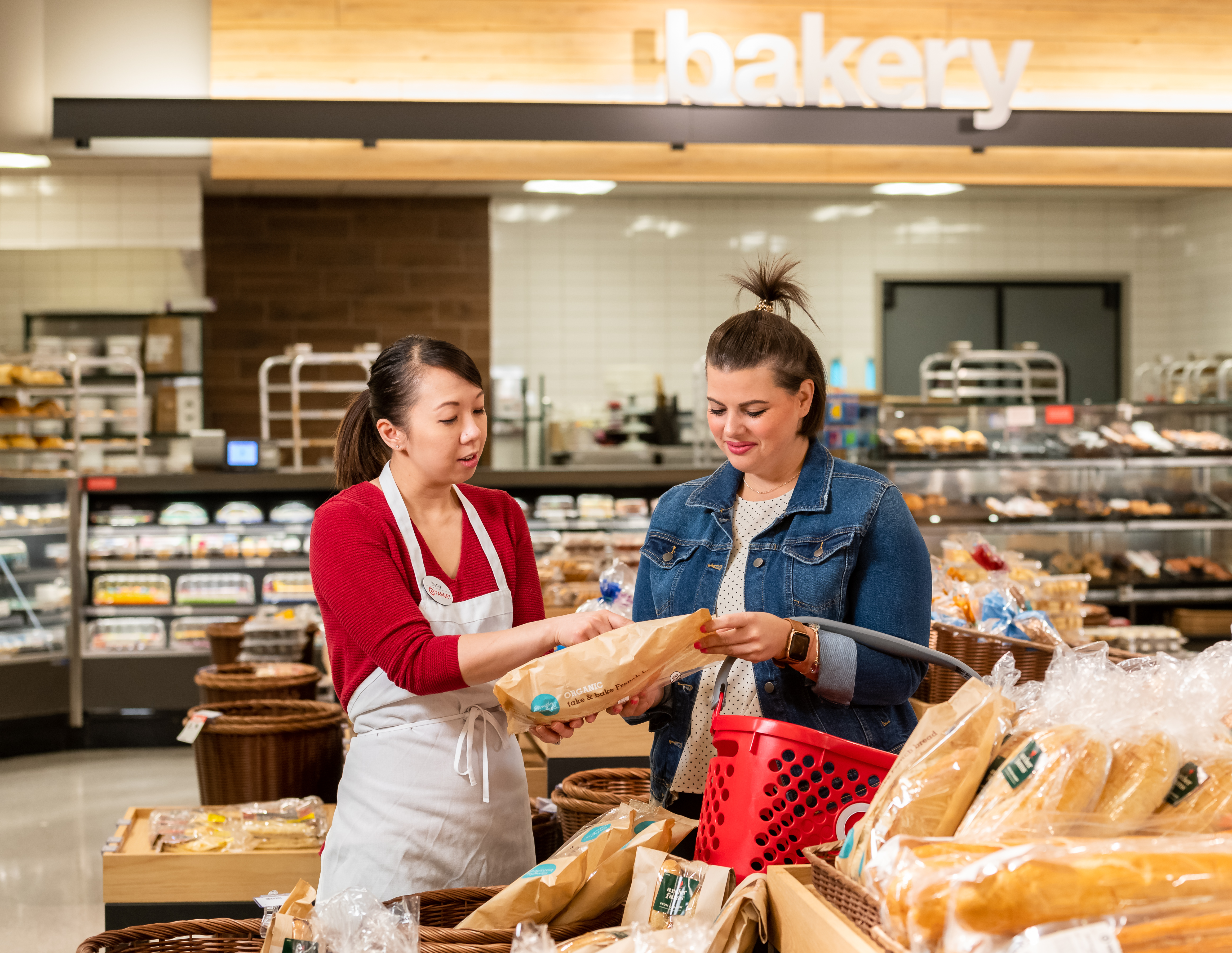 Target team member assisting a guest in the bakery.