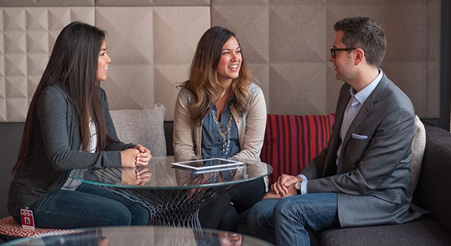 marketing team members talk during a meeting