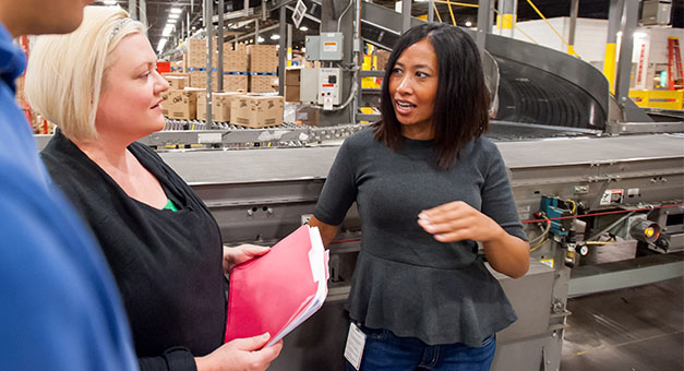 Target team members talk to one another in a distribution center