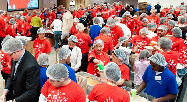 Target team members and 200 Minneapolis students assembling meals for a relief effort.