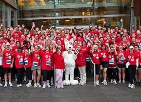 team members and Bullseye before a marathon