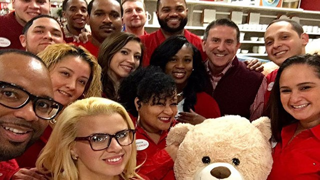 group of team members take a selfie with ceo Brian Cornell