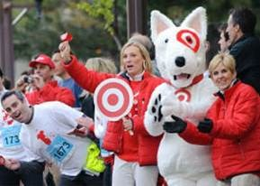 team members and Bullseye cheer for runners