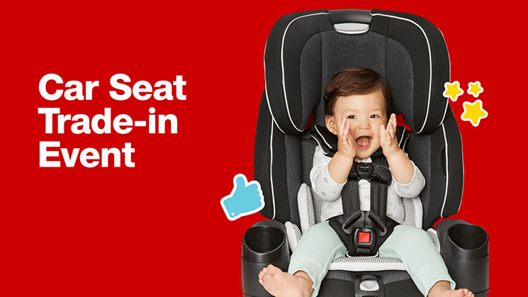 baby smiling in black car seat with Car Seat Trade-in text