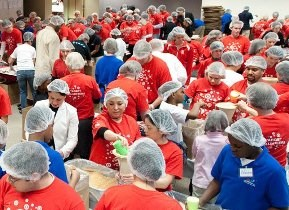 team members packing food donations